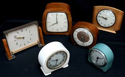 Six old  wind up smiths clocks  some work some don't  You win all six clocks