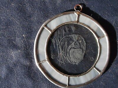 Japanese Chin  - Hand engraved ornament by Ingrid Jonsson.