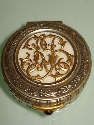 Russian silver box with gold monogram enamel and garnet.