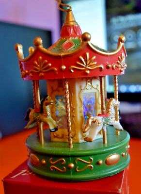 "Red, Green & Gold Carousel Christmas Ornament - 4 Horses On Poles - 4"" Tall"