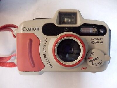 Canon Sure Shot WP-1 35mm Waterproof Camera with case/new battery.