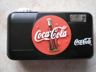 Coca Cola  black camera with 35 mm film inside 1999 collectible, novelty item