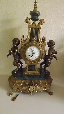 Large Beautiful Imperial Antique MantelClock, brass and marble with key.