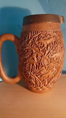 Holzkrug mit Schnitzerei - sehr detailliert! Wooden jug with intricate carvings.