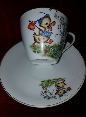 antique childs  porcelain cup and saucer