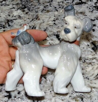 Lladro UNEXPECTED VISIT Terrier Dog w Bird on Tail Figurine #6829 2001