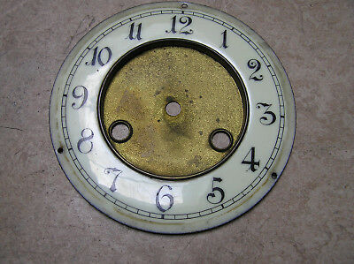 French clock spare, enamel chapter ring on brass centre.
