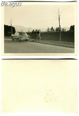 Vintage blurry Photo circa 1960s People with car ,landscape