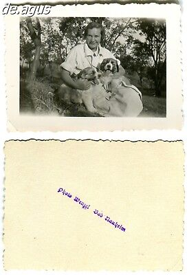 Vintage Photo circa 1940s beautiful young woman holding two cute puppies