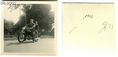 Vintage blurry Photo from 1956 young Man with litte boy on BMW? Motorbike