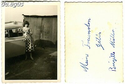 Vintage Photo circa 1960s young woman wearing nice dress with car