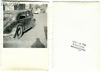 Vintage Photo circa 1960s rear view from classic car,shadow of photographer