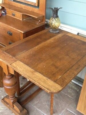 antique table oak side drop leaf table  36 X 48 when both sides are up