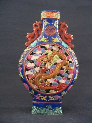 A Chinese reticulated porcelain Moon Flask, Qianlong incised mark but later.
