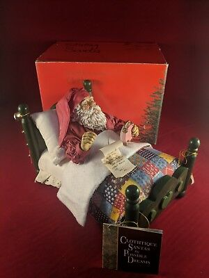 Possible Dreams® Clothtique - Santa In Bed #713076 - Musical Santa Figurine