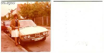 Vintage color Photo circa 1970s young woman with BMW CS 2800