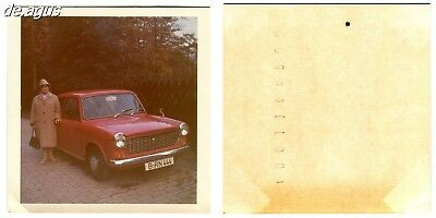 Vintage color Photo circa 1960s woman in winter coat,red car fiat 1500?