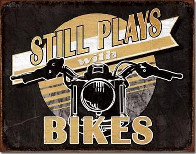 Still Plays With Bikes Motorcycle Enthusiasts Rustic Tin Metal Sign