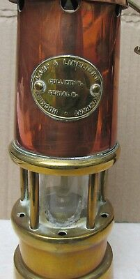 A Brass and Copper Ornamental Miner's Lamp