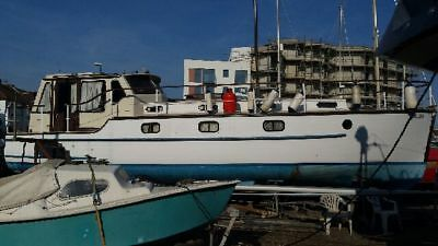 Rampart 100 HP 36 ft Classic Motor Cruiser offered for quick sale.