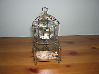 Novelty Clock With Two Birds Sitting On A Globe In A Brass Cage