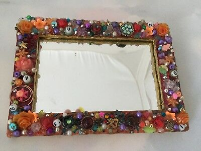 assemblage - outsider art colorful mirror made from found objects
