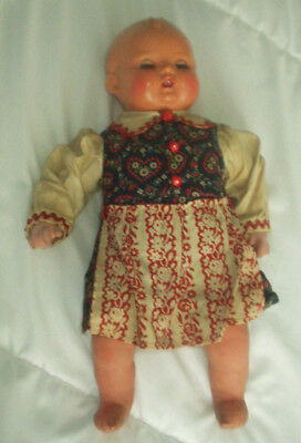 AN ANTIQUE GERMAN CHARACTER DOLL IN ORIGINAL CLOTHES - 1930's