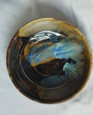 Studio pottery footed bowl with tenmoku, brown+ blue running glazes.NH / MH mark