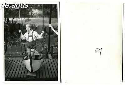 Vintage Photo circa 1950s cute boy standing on wooden swing