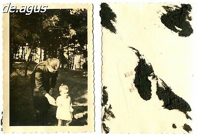 Vintage Photo circa 1940s woman with little girl , forest