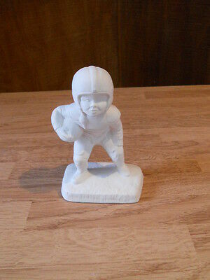 C-0634 Small Boy Football Player; Holding Football Ceramic Bisque U Paint
