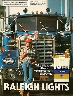 1982 Raleigh Lights Cigarettes Trucker Smokes,Leans on Kenworth Vintage Print Ad
