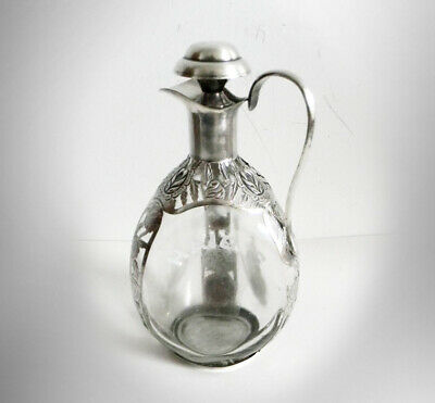 Haig pinch bottle with sterling silver overlay - with cap and handle