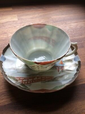 Vintage Japanese eggshell porcelain cup and saucer in excellent condition