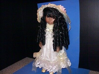 "Lovely Porcelain African American Doll 16"" ( fully dressed from head to toe)"