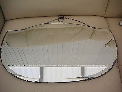 Vintage large shield shaped  bevelled edge mirror with chain