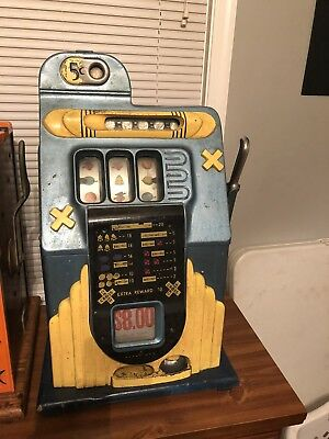 Antique Buckley Slot Machine, original condition Mills black Cherry Revamp Token