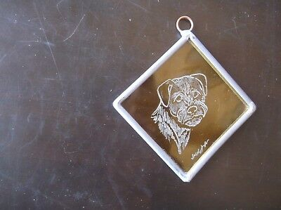 Border Terrier-  Beautifully  Hand Engraved  Ornament by Ingrid Jonsson.