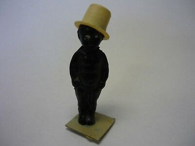 Black Americana Celluloid Frozen Charlie with White Top Hat