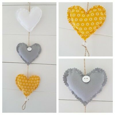 Handmade vertical fabric Hanging Hearts 3 in Grey/white and mustard (yellow).