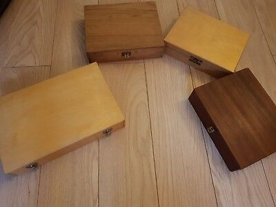 Used. Projection trays with over 200 slides in wooden storages cases.  LOT 7012