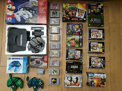 N64 console set with 3 additional controllers and 23 games