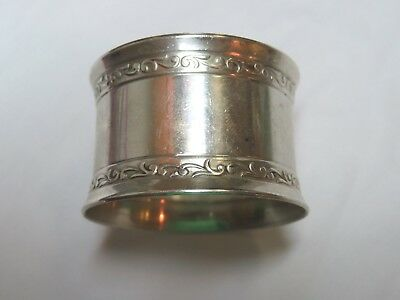 A Wallace 7413 Sterling Silver Napkin Ring With Intricate Design
