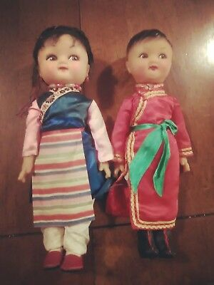 set of 2 vintage asian rubber dolls boy and girl w/colorful clothes