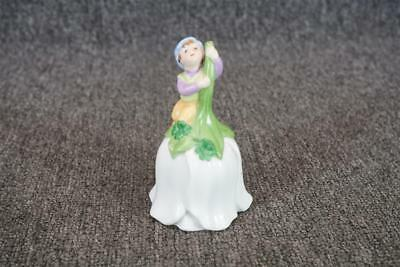 """Avon 1983 Flower Shaped Ceramic Bell With Boy On Handle 4.5"""" Tall"""