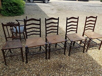 Antique chairs collection, rush seat ladderback, elbow and cane seat.