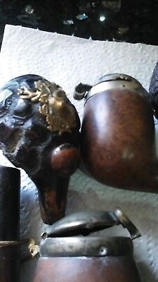 collection of antique and vintage smoking pipes