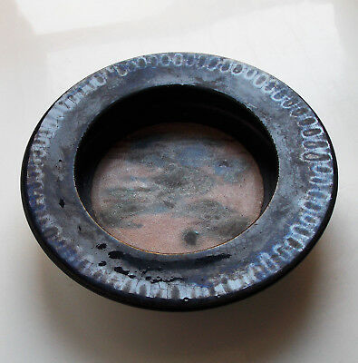 Bruno Gambone, A Round Black Glazed Bowl Internally Decorated With Colored Spots