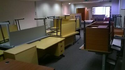 Used office furniture, including desks, filing cabinets, drawers, chairs