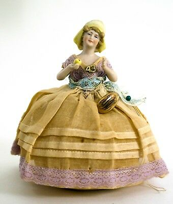 Antique arms away pincushion half doll holding pear day cap bonnet gold jewelry